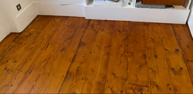 example of Hardwood floor renovation and staining with dark oak lacquer, Chelsea