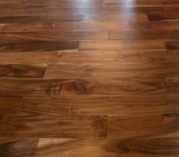 Before and after  Parquet restoration and finishing, Haringey