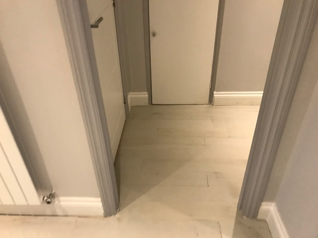 example of Floor repair and gap filling of solid wood flooring in a hallway, Lambeth