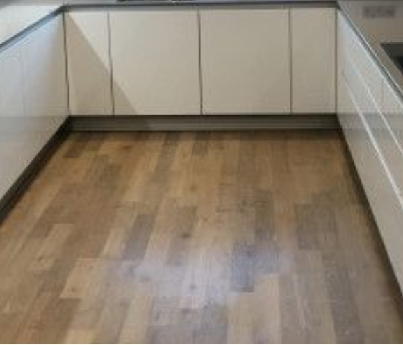 Solid wood flooring sanding and reclaiming in kitchen, Canary Wharf